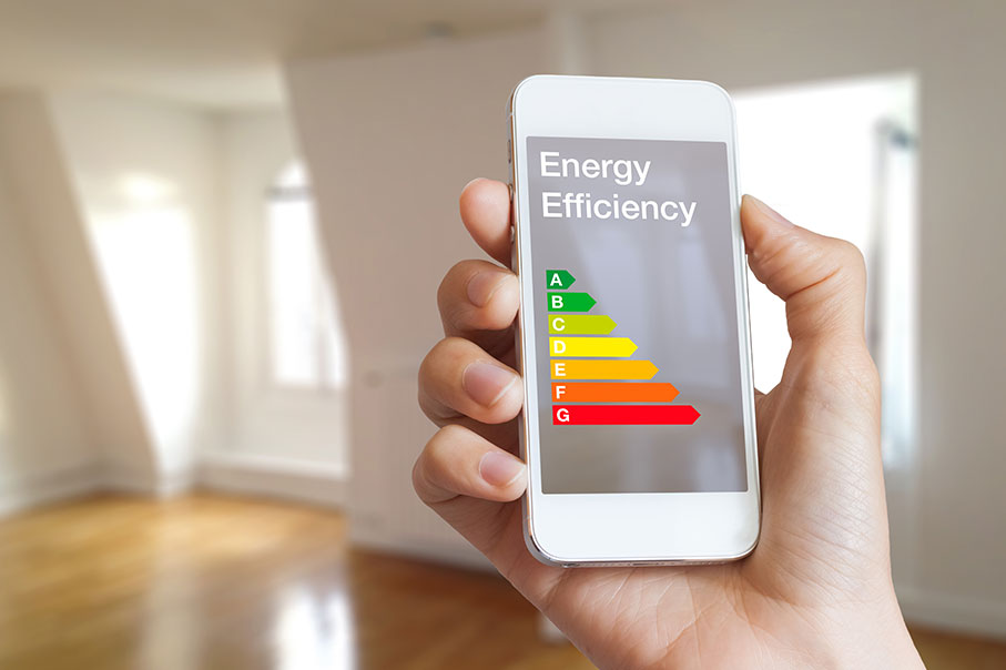 Energy Performance Certificate Chart Displayed On A Mobile Phone With Empty Room In THe Background