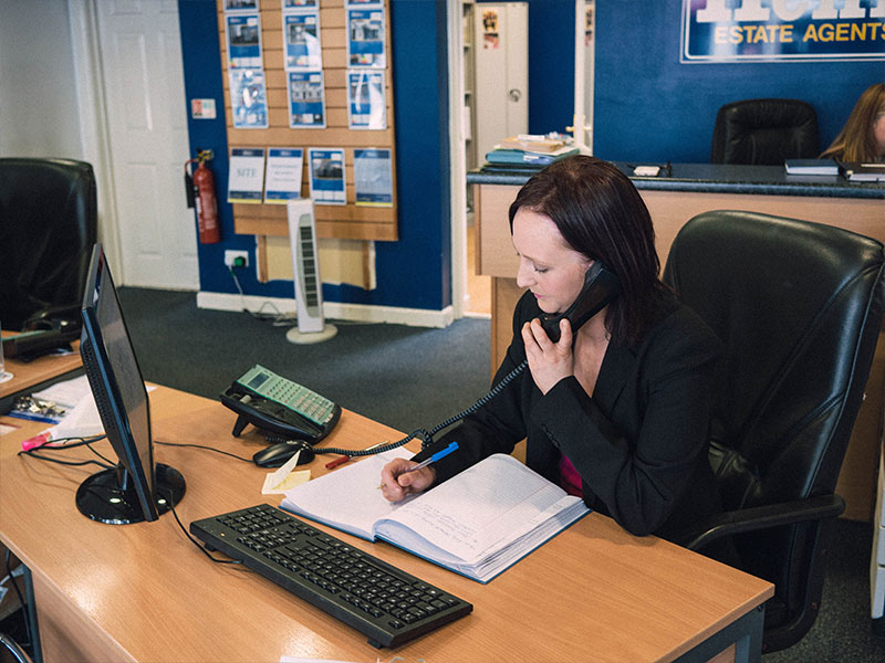 Daniel Henry Staff Member Talking On A Phone About Mortgages