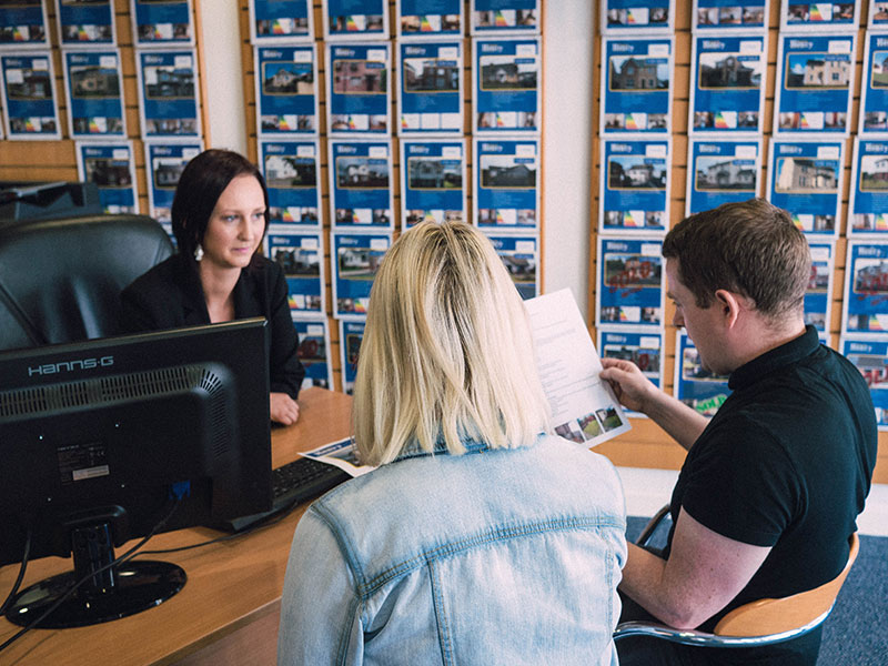 Daniel Henry Staff Member Providing A Young Couple With A Property Valuation