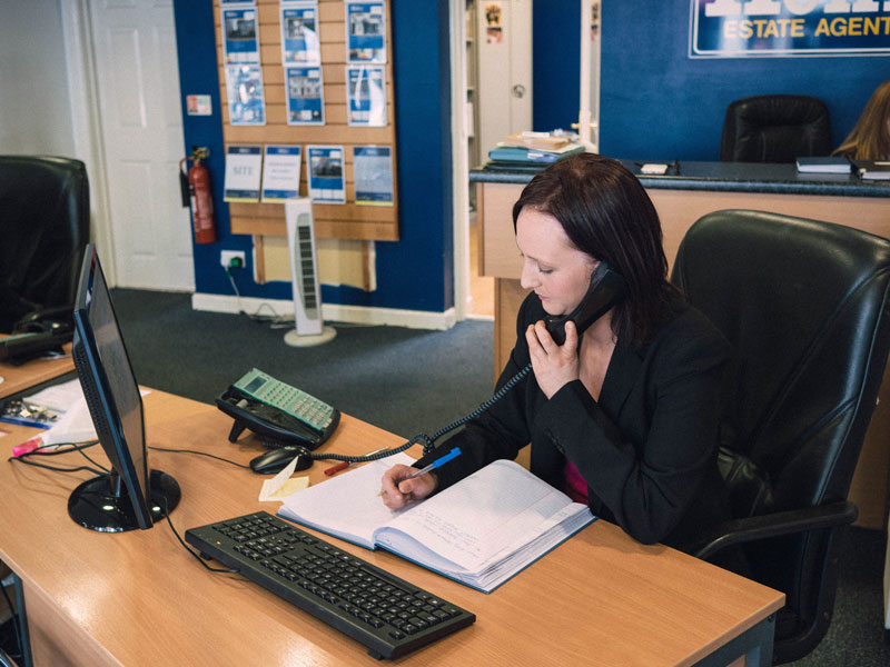 Daniel Henry Staff Member Talking On A Phone About Property Valuations